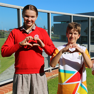 Students making hand heart